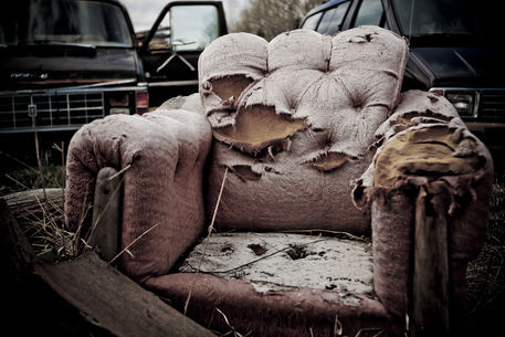 old-sofa-chair-trucks behind